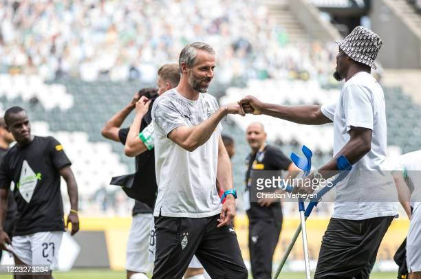 MOENCHENGLADBACH GERMANY JUNE Head Coach Marco Rose and Marcus Thuram of Borussia Moenchengladbach celebrate their Teams win and the Qualification...