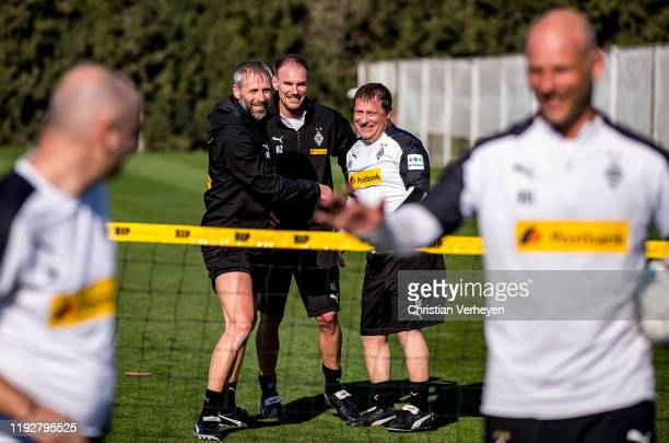 Head Coach Marco Rose Assistant Coach Alexander Zickler and Director of Sport Max Eberl of Borussia Moenchengladbach are seen during the Borussia...