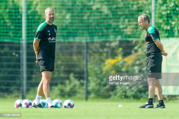 Head coach Marco Rose of Borussia Moenchengladbach and assistant coach Frank Geideck of Borussia Moenchengladbach looks on during day 3 of the...