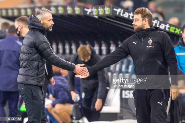 head coach Marco Rose of Borussia Moenchengladbach and assistant coach Rene Maric of Borussia Moenchengladbach looks dejected after the Bundesliga...