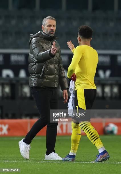 Head coach Marco Rose of Moenchengladbach shakes hands with Jadon Sancho of Dortmund during the Bundesliga match between Borussia Moenchengladbach...