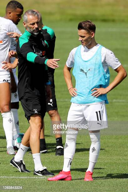 Head coach Marco Rose speaks to Hannes Wolf during the first training session after the summer break at Training Ground on August 04, 2020 in...