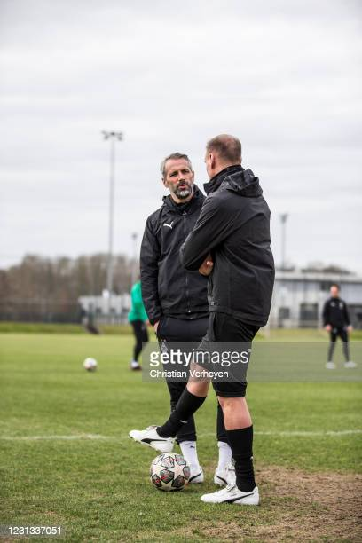 Head Coach Marco Rose talks to Assistant Coach Alexander Zickler during a team training session of Borussia Moenchengladbach ahead the UEFA Champions...