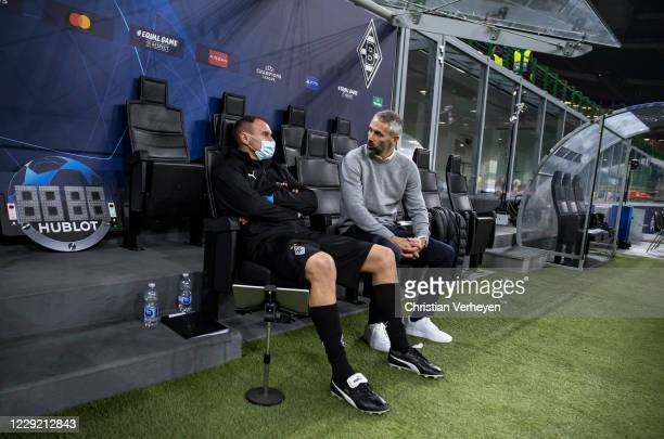 Head Coach Marco Rose talks to Assistant Coach Alexander Zickler of Borussia Moenchengladbach after the Group B - UEFA Champions League match between...