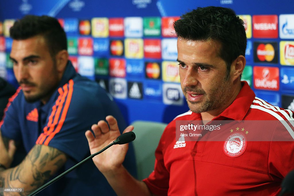 Head coach Marco Silva (front) and goalkeeper Roberto attend a Olympiacos FC press conference ahead of their UEFA Champions League Group F match against Bayern Muenchen at Karaiskakis Stadium on September 15, 2015 in Athens, Greece.