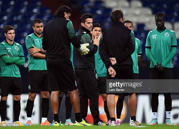 Head coach Marco Silva gives instructions to his players during a Sporting Club de Portugal training session at Veltins Arena on October 20 2014 in...