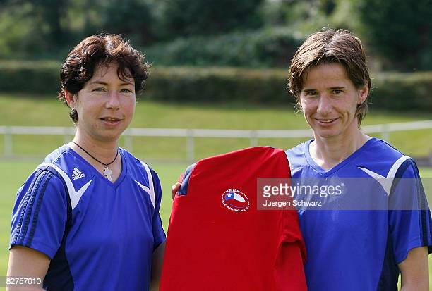 Head coach Maren Meinert and coach Bettina Wiegmann pose with a shirt of the Chilean football association during the photo call of the U20 women...