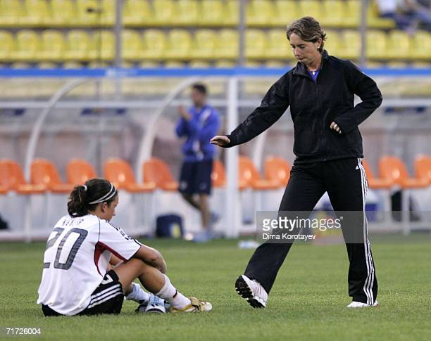 Head coach Maren Meinert consoles Nadine Kessler of Germany after their team lost the FIFA Women's Under 20 World Championships Quarter-final match...