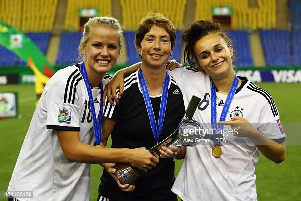 Head coach Maren Meinert , Lena Petermann and Lina Magull of Germany pose after winning the FIFA U-20 Women's World Cup Canada 2014 final match...