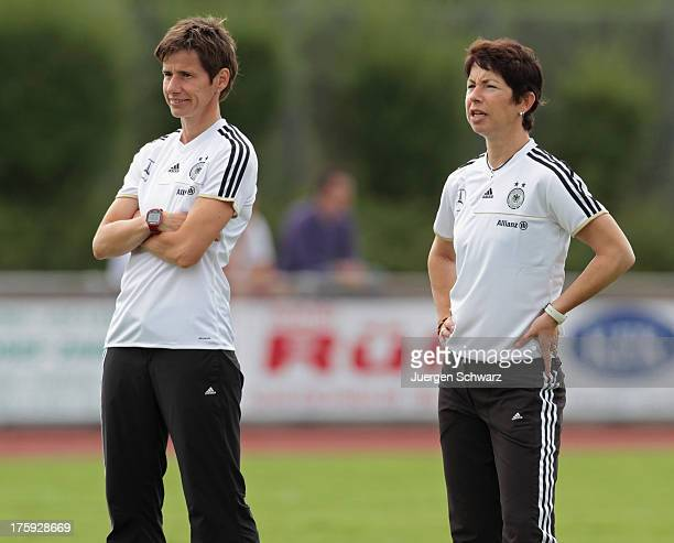 Head coach Maren Meinert of Germany and Bettina Wiegmann watch their players warming up at the Women's friendly match between U19 Germany and U21...