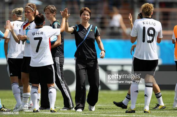 Head coach Maren Meinert of Germany celebrates with her team after winning the FIFA U20 Women's World Cup Group A match between Germany and Costa...