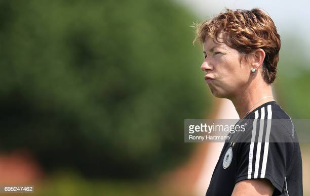 Head coach Maren Meinert of Germany looks on during the U19 women's elite round match between Poland and Germany at Stadion Sandersdorf on June 12...
