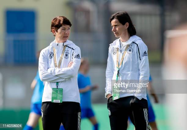 Head coach Maren Meinert of Germany speaks to assistant coach Bettina Wiegmann prior to the UEFA Women's U19 European Qualifier match between Germany...