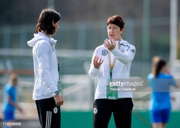 Head coach Maren Meinert of Germany speaks to assistant coach Bettina Wiegmann prior to the UEFA Women's U19 European Qualifier match between Germany...