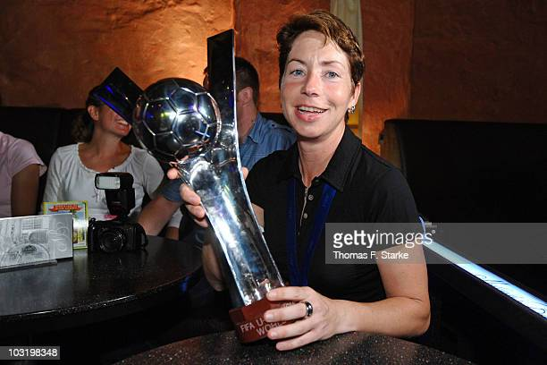 Head coach Maren Meinert poses with the world cup trophy during the Champions Party of the german U20 women's team at the 'Miloudi's Bar' on August 1...