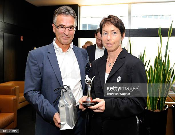 Head coach Maren Meinert receives a honor from Helmut Sandrock general secretary of German Football Association during the Germany Women's National...