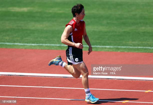 Head coach Maren Meinert runs during a training session ahead of the FIFA U20 Women's World Cup Japan 2012 Final match between the United States and...