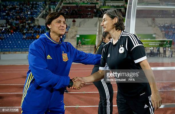 Head Coach Maria Is of Spain shake hands wit head coach Anouschka Bernhard of Germany prior to the FIFA U17 Women's World Cup Quarter Final match...