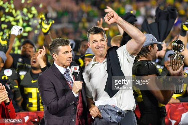 Head coach Mario Cristobal of the Oregon Ducks celebrates the win with his team after the game against the Wisconsin Badgers at the Rose Bowl on...