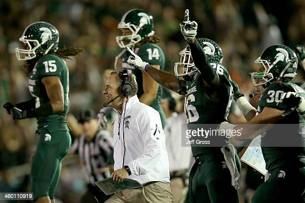 Head coach Mark Dantonio and the Michigan State Spartans celebrate stopping the Stanford Cardinal on fourth down to take possesion in the final...