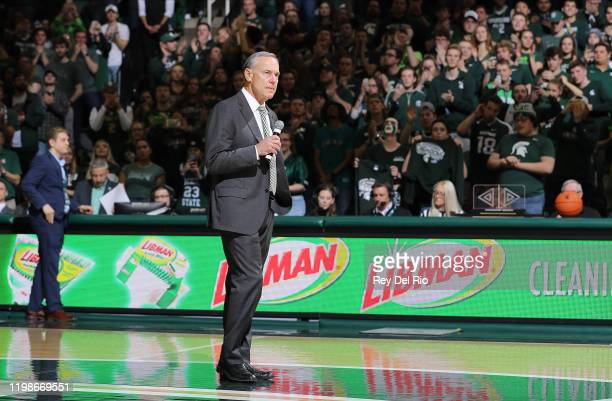 Head coach Mark Dantonio of the Michigan State Spartans address the crowd during halftime of a college basketball game between the Michigan State...