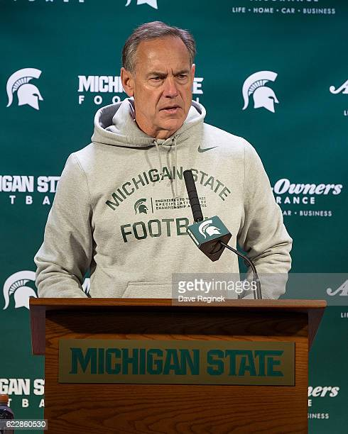 Head coach Mark Dantonio of the Michigan State Spartans addresses the media after a college football game against the Rutgers Scarlet Knights at...