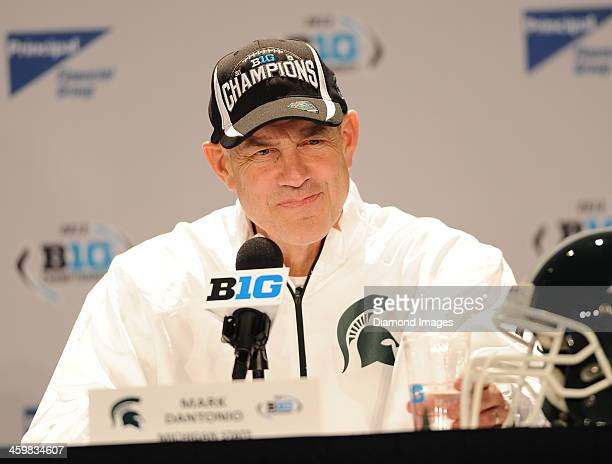 Head coach Mark Dantonio of the Michigan State Spartans answers questions from the media during the post game press conference after a game against...