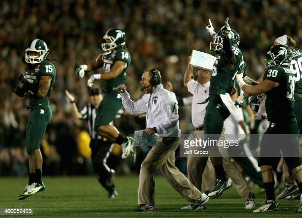 Head coach Mark Dantonio of the Michigan State Spartans celebrates stopping the Stanford Cardinal on fourth down to take possesion in the final...