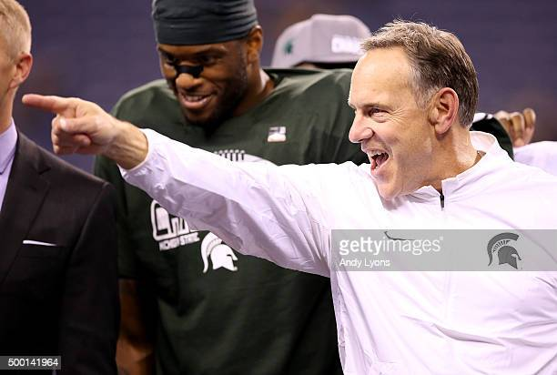 Head coach Mark Dantonio of the Michigan State Spartans celebrates after beating the Iowa Hawkeyes in the Big Ten Championship at Lucas Oil Stadium...