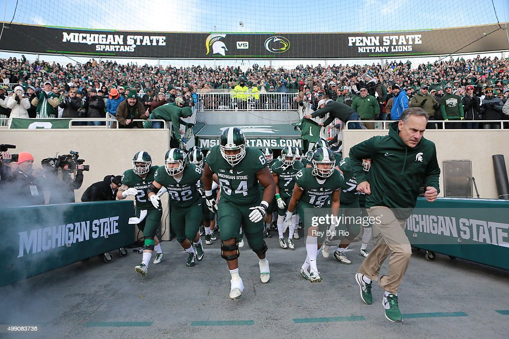 Head coach Mark Dantonio of the Michigan State Spartans leads his team onto the field prior to a game against the Penn State Nittany Lions at Spartan Stadium on November 28, 2015 in East Lansing, Michigan.
