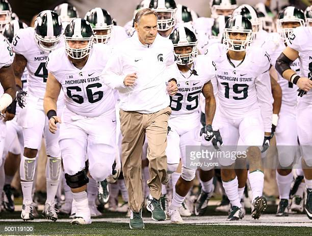Head coach Mark Dantonio of the Michigan State Spartans leads his team onto the field before the game against the Iowa Hawkeyes in the Big Ten...