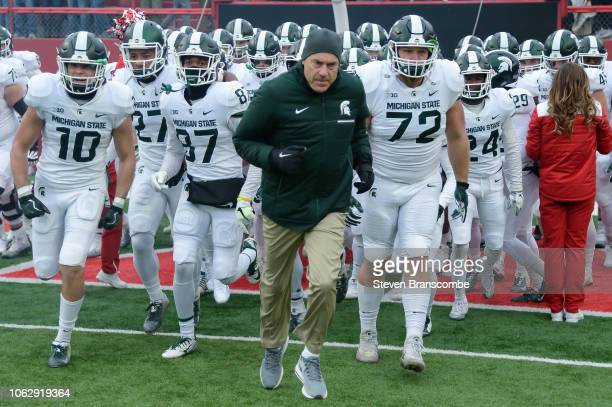 Head coach Mark Dantonio of the Michigan State Spartans leads the team on the field before the game against the Nebraska Cornhuskers at Memorial...