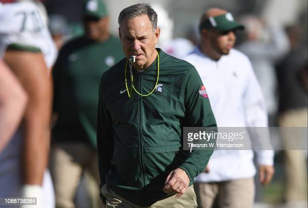 Head coach Mark Dantonio of the Michigan State Spartans looks on while his team warms up prior to the start of the Redbox Bowl against the Oregon...