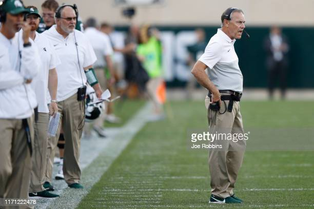 Head coach Mark Dantonio of the Michigan State Spartans looks on in the first quarter against the Tulsa Golden Hurricane at Spartan Stadium on August...