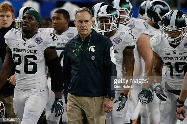 Head coach Mark Dantonio of the Michigan State Spartans looks on before taking on the Alabama Crimson Tide in the Goodyear Cotton Bowl at ATT Stadium...