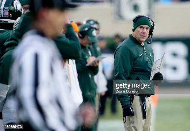 Head coach Mark Dantonio of the Michigan State Spartans looks towards an official after a penalty was called against the Spartans during the first...