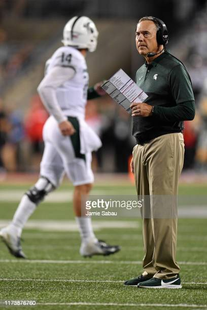 Head Coach Mark Dantonio of the Michigan State Spartans looks up at the scoreboard as his team prepares to kick a field goal in the second quarter...