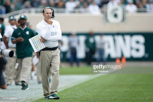 Head coach Mark Dantonio of the Michigan State Spartans reacts after a touchdown by the Indiana Hoosiers in the first quarter at Spartan Stadium on...