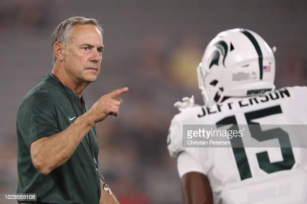 Head coach Mark Dantonio of the Michigan State Spartans reacts during warm ups to the college football game against the Arizona State Sun Devils at...