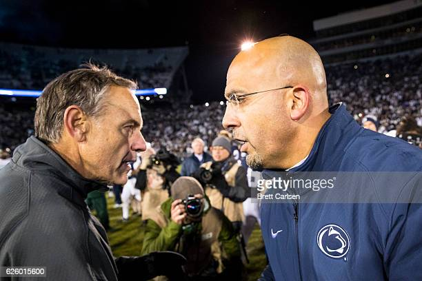 Head coach Mark Dantonio of the Michigan State Spartans shakes hands with head coach James Franklin of the Penn State Nittany Lions after the game on...