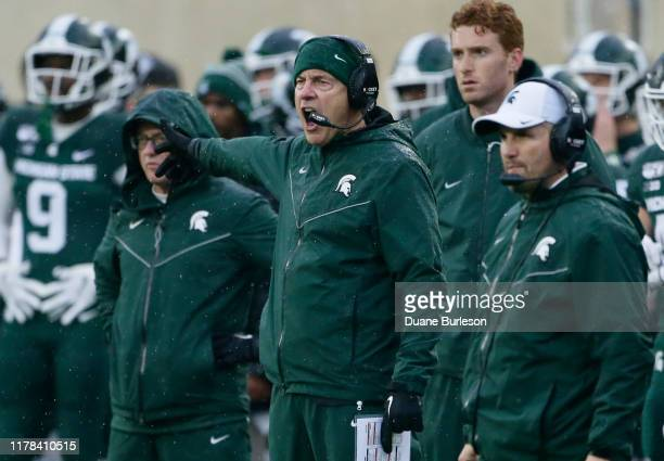 Head coach Mark Dantonio of the Michigan State Spartans shouts at an official during the first half of a game against the Penn State Nittany Lions at...