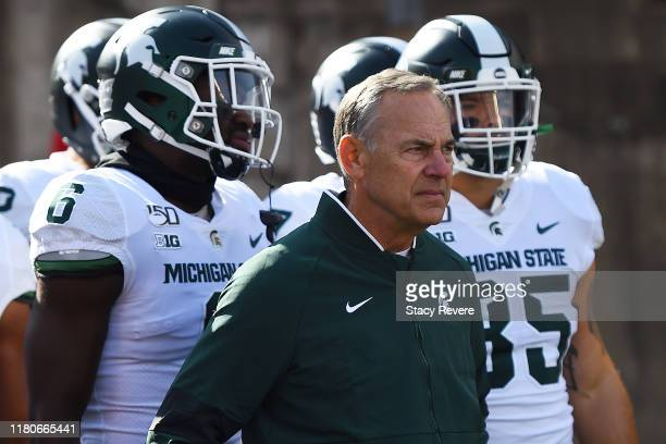 Head coach Mark Dantonio of the Michigan State Spartans takes the field with his team prior to a game against the Wisconsin Badgers at Camp Randall...
