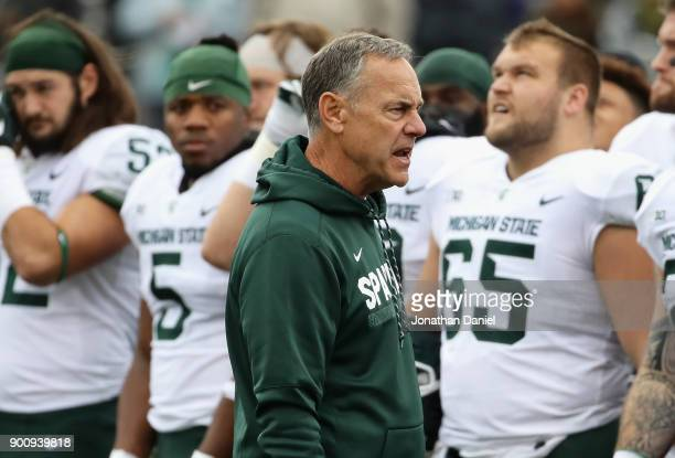 Head coach Mark Dantonio of the Michigan State Spartans talks to his team before a game against the Northwestern Wildcats at Ryan Field on October 28...