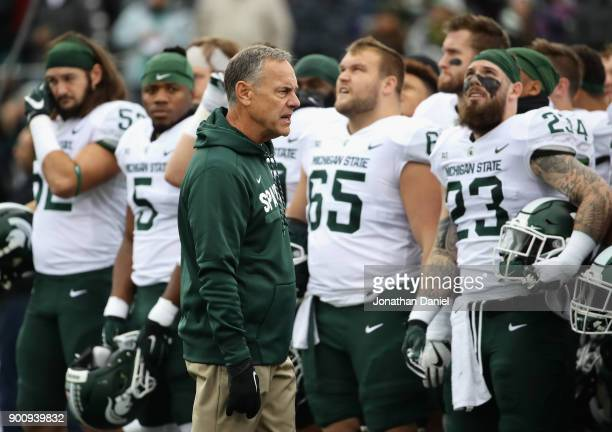 Head coach Mark Dantonio of the Michigan State Spartans talks to his team before a game against the Northwestern Wildcats at Ryan Field on October...