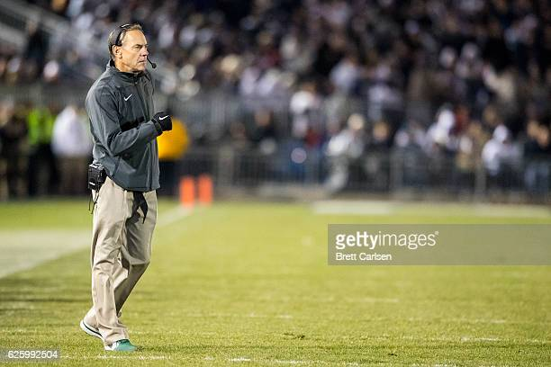 Head coach Mark Dantonio of the Michigan State Spartans walks onto the field between plays during the first half against the Penn State Nittany Lions...