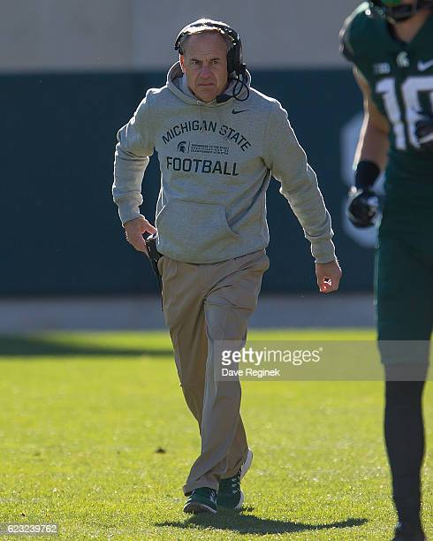 Head coach Mark Dantonio of the Michigan State Spartans walks the sidelines in the first quarter during a college football game against the against...