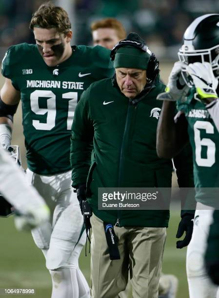 Head coach Mark Dantonio of the Michigan State Spartans walks the sidelines during the second half of a game against the Rutgers Scarlet Knights at...
