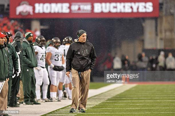 Head Coach Mark Dantonio of the Michigan State Spartans watches from the sideline as his team plays against the Ohio State Buckeyes in the first half...