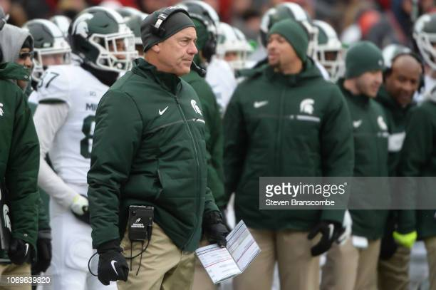 Head coach Mark Dantonio of the Michigan State Spartans watches action against the Nebraska Cornhuskers at Memorial Stadium on November 17 2018 in...