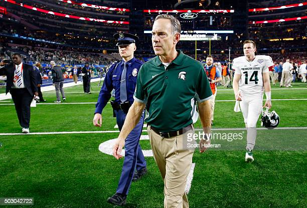 Head coach Mark Dantonio walks off the field after losing 380 to the Alabama Crimson Tide during the Goodyear Cotton Bowl at ATT Stadium on December...